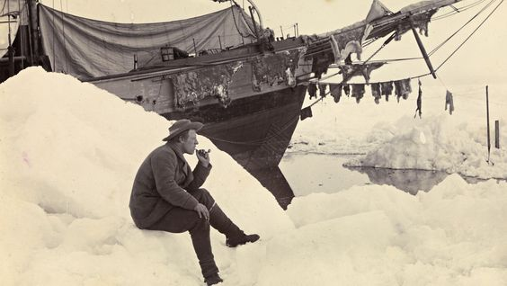 Fridtjof Nansen sits and smokes a pipe in front of 'Fram', Polar Sea, 16th June 1894.